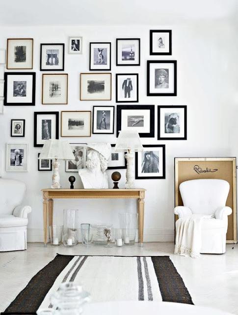 Come arredare la parete con quadri c spazio soluzioni for Cornici a muro per foto